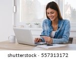 girl paying with credit card... | Shutterstock . vector #557313172