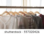 clothes hang on a shelf in a... | Shutterstock . vector #557320426