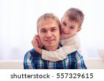 close up of joyful father and... | Shutterstock . vector #557329615