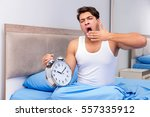 Small photo of Man having trouble waking up in morning