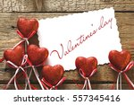valentines day. red hearts on... | Shutterstock . vector #557345416