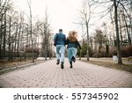 guy and girl run away on the... | Shutterstock . vector #557345902