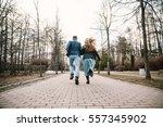 guy and girl run away on the... | Shutterstock . vector #557345902