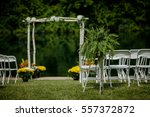 wedding ceremony setting outdoo | Shutterstock . vector #557372872