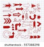 doodle red pen sketch arrows on ... | Shutterstock .eps vector #557388298