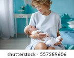 young mother holding her... | Shutterstock . vector #557389606
