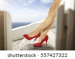 woman legs and heels  | Shutterstock . vector #557427322