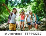 group of tourists exploring... | Shutterstock . vector #557443282
