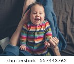 A Happy Laughing Baby Lying In...