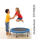 Kids having fun with a trampoline in the gym - isolated, slight motion blur - stock photo