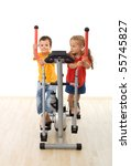 Kids having fun playing on exercise equipment - isolated - stock photo