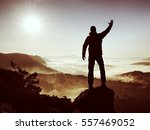 happy man with raised arms... | Shutterstock . vector #557469052