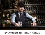 Stock photo bartender bartender is pouring a drink 557472538