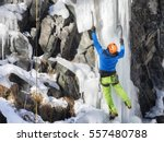 man climbing ice in mountain | Shutterstock . vector #557480788