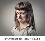 disgusted child's portrait | Shutterstock . vector #557495155
