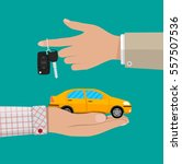 hand with yellow car and keys.... | Shutterstock .eps vector #557507536