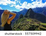 young woman looking at machu... | Shutterstock . vector #557509942