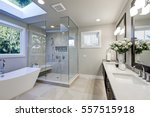 Spacious bathroom in gray tones ...