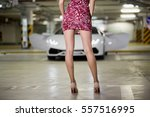 legs of young woman poses... | Shutterstock . vector #557516995