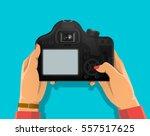 photograph's hands holding dslr ... | Shutterstock .eps vector #557517625