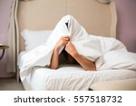 woman hiding under a blanket.... | Shutterstock . vector #557518732