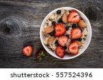 oatmeal porridge with ... | Shutterstock . vector #557524396