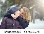 happy young couple in winter... | Shutterstock . vector #557583676