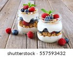 healthy blueberry and raspberry ... | Shutterstock . vector #557593432