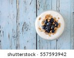 greek yogurt with blueberries... | Shutterstock . vector #557593942