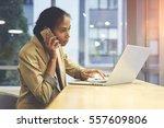 skilled female director of... | Shutterstock . vector #557609806