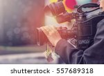 video camera operator working... | Shutterstock . vector #557689318