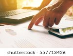 Small photo of Man hand pointing on summary report and thinking about cost at home office