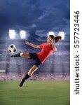 female soccer player kicking... | Shutterstock . vector #557723446