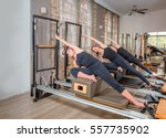 young women exercising on... | Shutterstock . vector #557735902