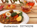 delicious curry and tea | Shutterstock . vector #557745298