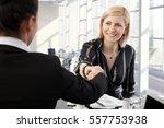 smiling businesswomen shaking... | Shutterstock . vector #557753938