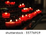 Red Glowing Candles In A Church