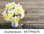 white daffodils at china vase... | Shutterstock . vector #557794675