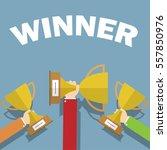 hands holding winner's cups.... | Shutterstock .eps vector #557850976