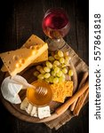 slate board with various cheese ...   Shutterstock . vector #557861818