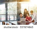 4 people meeting in coffee shop ... | Shutterstock . vector #557874865
