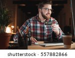 young smiling businessman with... | Shutterstock . vector #557882866