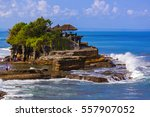 tanah lot temple in bali... | Shutterstock . vector #557907052