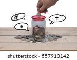hand of man insert a coin into... | Shutterstock . vector #557913142