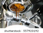 espresso coffee pouring from... | Shutterstock . vector #557923192