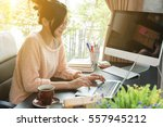 young beautiful girl working at ... | Shutterstock . vector #557945212