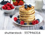 stack of pancakes with fresh... | Shutterstock . vector #557946316