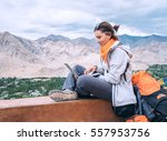 backpacker female with laptop... | Shutterstock . vector #557953756