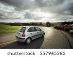 asphalt road with cars passing... | Shutterstock . vector #557965282