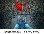 sad man standing alone on... | Shutterstock . vector #557975992